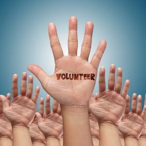 volunteer group raising hands